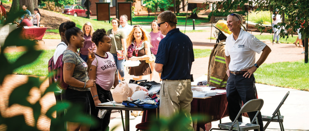 Students tour campus and talk with instructors at orientation.