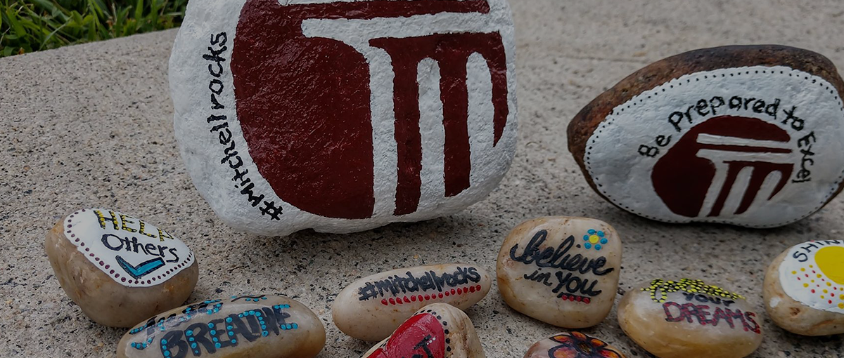 Rocks with the Mitchell logo and hashtag Mitchell Rocks