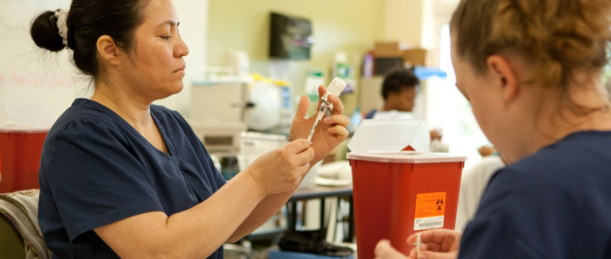 Medical Assisting students practice in the classroom