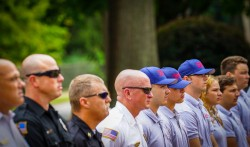A line of public safety officers stands at attention during the 9-11 ceremony.
